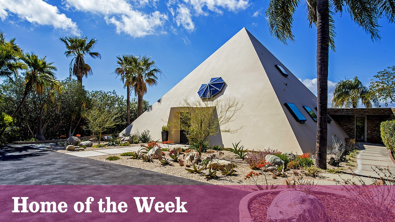 """The offbeat home, which sits on a lot of 2 acres, has three bedrooms and 2.5 bathrooms, including a """"queen's chamber"""" master suite found at the apex of pyramid."""