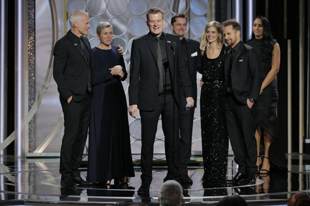 """Graham Broadbent, producer of """"""""Three Billboards Outside Ebbing, Missouri,"""" accepts the award for motion picture - drama at the 75th Golden Globe Awards on Sunday."""