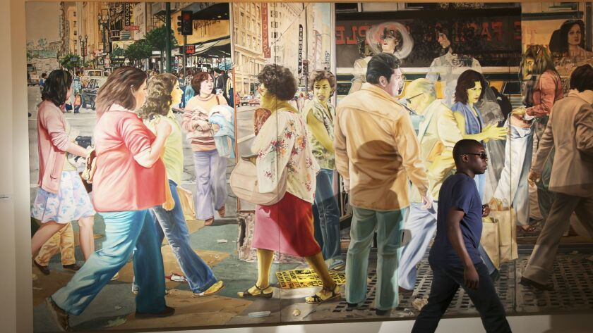 """Artist John Valadez's """"The Broadway Mural"""" (1981) hangs in the Santa Monica offices of the Rand Corp."""