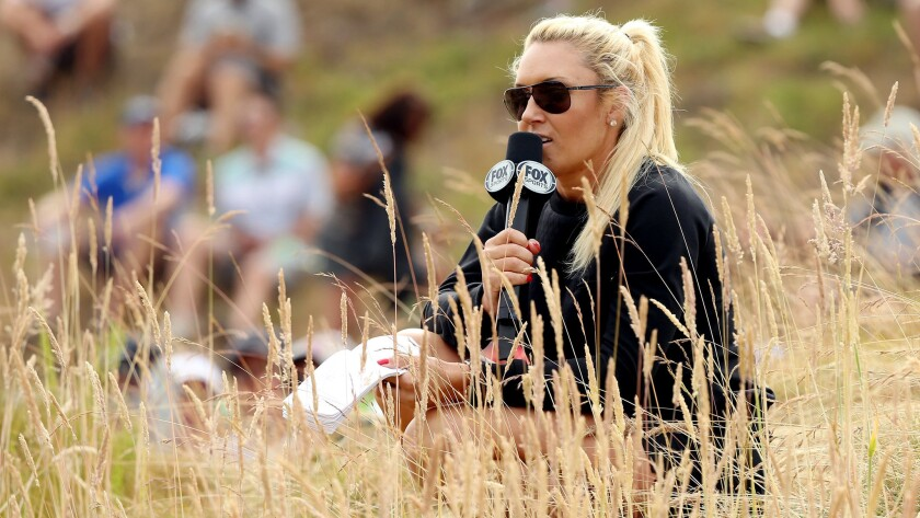 LPGA player Natalie Gulbis reports from the course during Fox Sports' coverage of the 115th U.S. Open at Chambers Bay Golf Course in University Place, Wash., on Thursday.