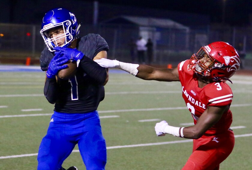 Culver City receiver Tanner Duve makes a catch behind Lawndale defender Ma'Kai Williams on Friday.