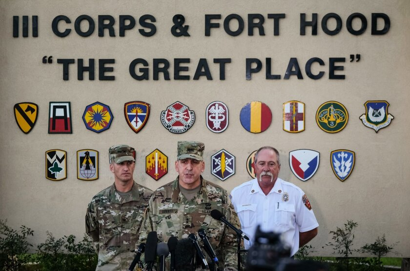 Maj. Gen. John Uberti, Fort Hood deputy commander, center,  Col. Todd Fox, left, and Fort Hood fire chief Coleman Smith, right, speak  to the media during a news conference in Fort Hood, Texas, on Friday, June 3, 2016.  Officials say Fort Hood commanders were in the process of closing roads on the