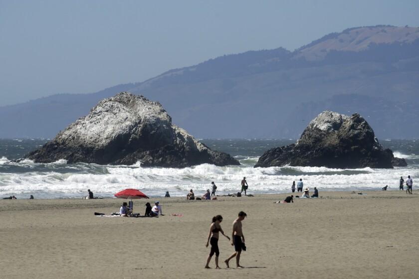 People visit Ocean Beach during the coronavirus outbreak in San Francisco