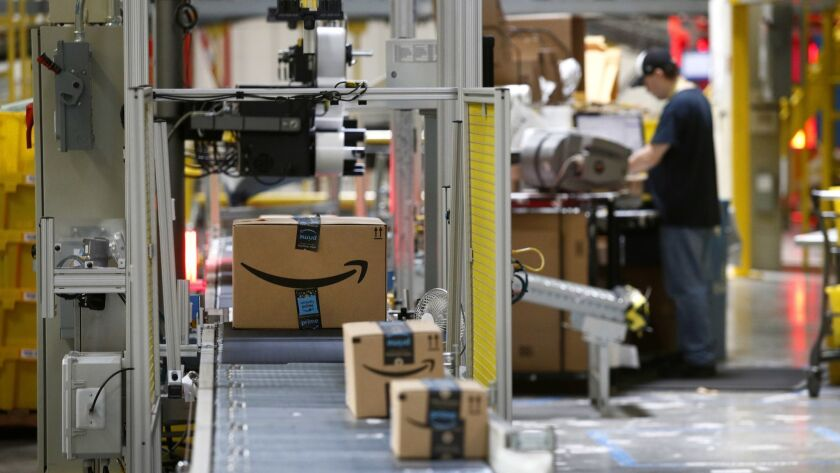 Packages pass through a scanner at an Amazon fulfillment center in Baltimore.