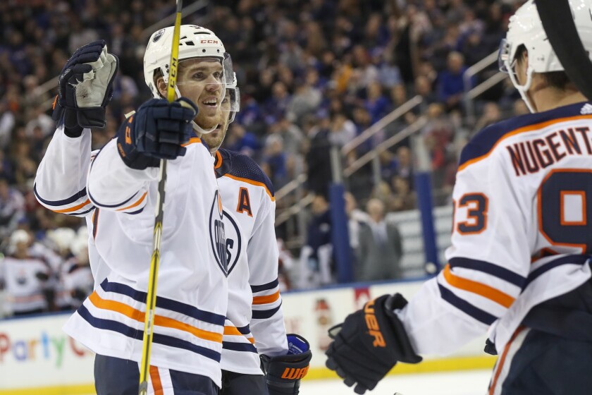 Edmonton Oilers center Connor McDavid (97) celebrates after scoring a goal against the New York Rangers during the third period of an NHL hockey game, Saturday, Oct. 12, 2019, at Madison Square Garden in New York. The Oilers won 4-1. (AP Photo/Mary Altaffer)
