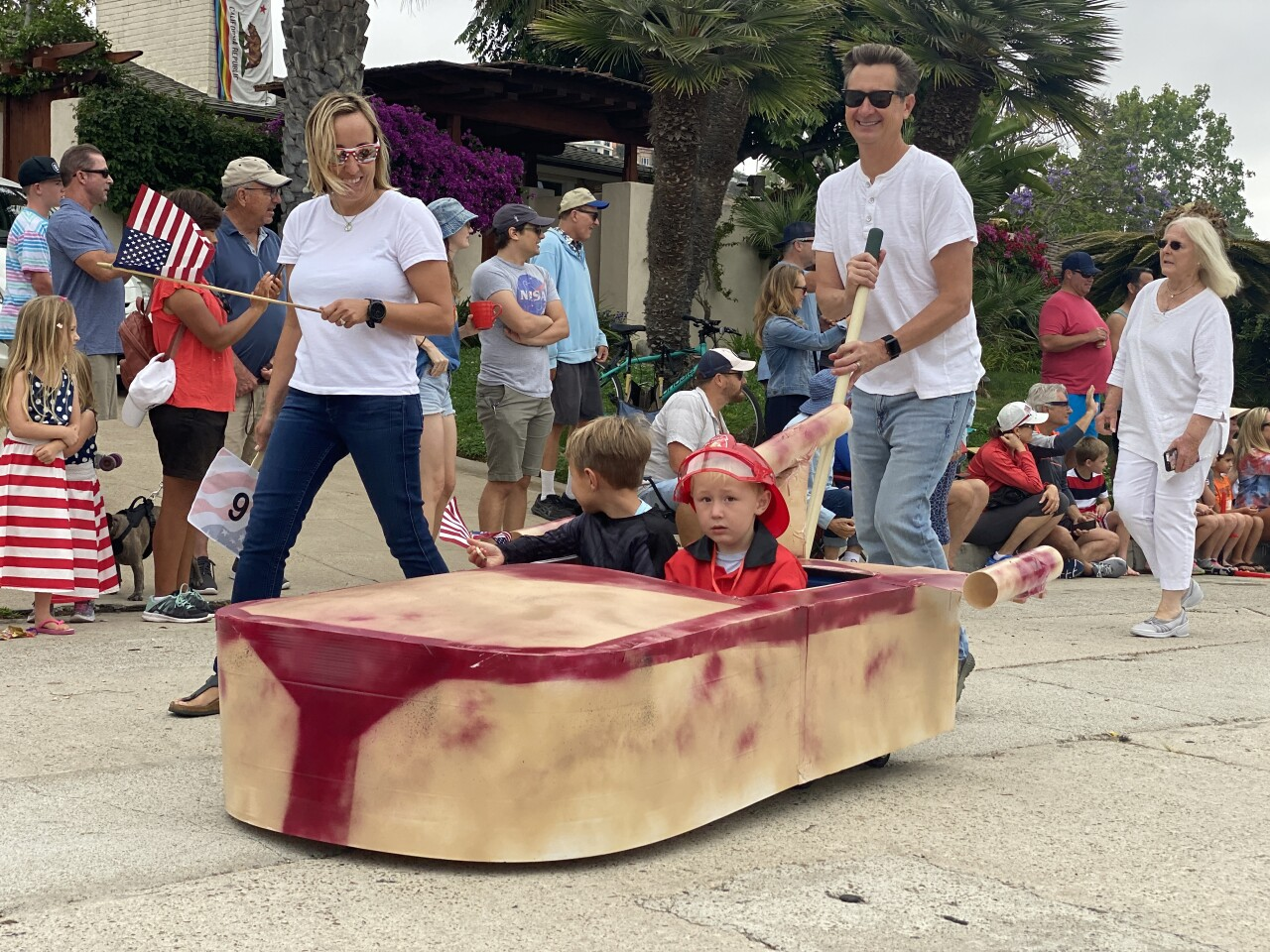 """Jake (left) and John Hannan said they were happy to be riding on their """"Land Speeder"""" float."""