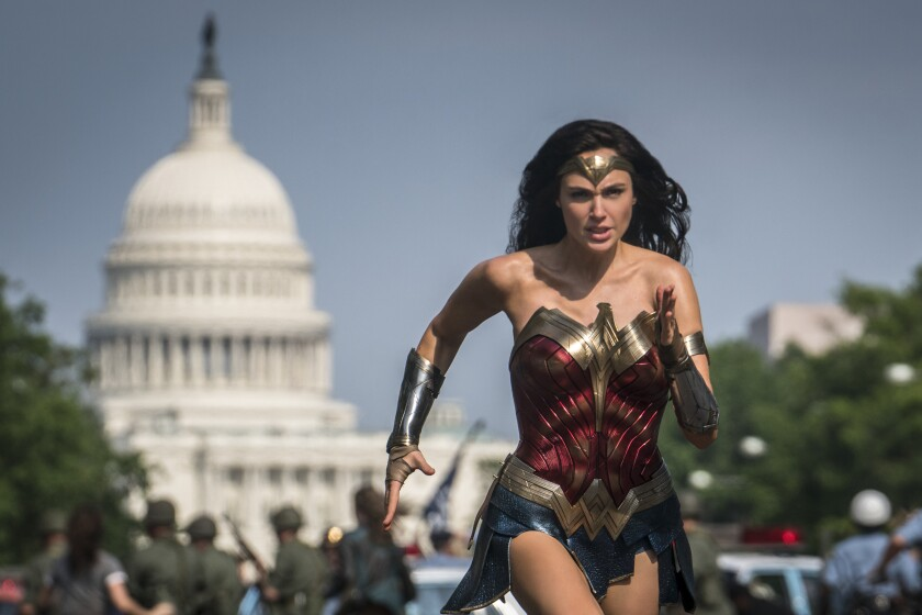 "This image released by Warner Bros. Pictures shows Gal Gadot as Wonder Woman in a scene from ""Wonder Woman 1984."" Warner Bros. will hold a 24-hour virtual event in August featuring the biggest heroes in the DC Comics universe. The studio announced Tuesday that DC FanDome will be held on the event's website on August 22 starting at 10 a.m. Pacific. Virtual panels will feature cast and creators from DC films including ""The Batman,"" ""Black Adam"" and ""Wonder Woman 1984. (Clay Enos/Warner Bros Pictures via AP)"