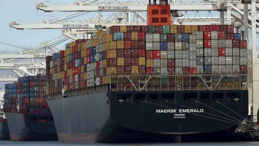 FILE - In this Thursday, July 12, 2018, file photo, the container ship Maersk Emerald is unloaded at