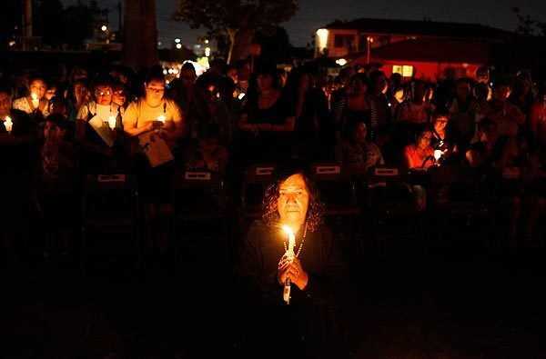 Rigoberto Ruelas' mother Rita holds a candle during a candlelight vigil for the Miramonte Elementary School teacher who committed suicide. See full story
