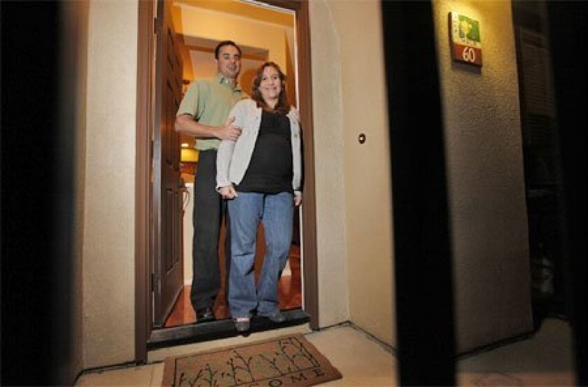 Damien and Candice Smith bought a foreclosed townhouse in  Logan Heights last month. Countywide, foreclosures were up  20 percent in December. (John R. McCutchen / Union-Tribune)
