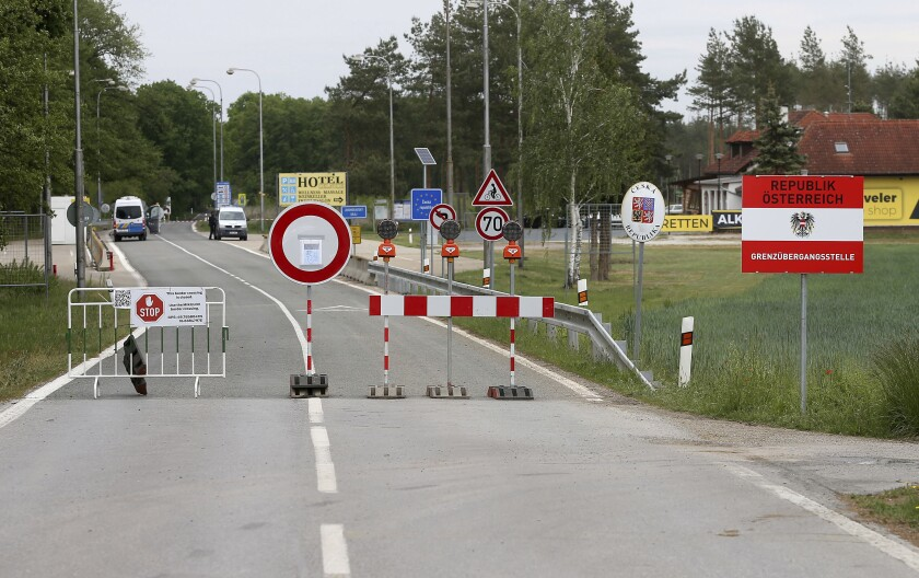 FILE - In this May 13, 2020 file photo, a barrier blocks the road at the closed border crossing from Austria to the Czech Republic near Reinthal, Austria. European Union countries are set to adopt a common traffic light system to coordinate traveling across the 27-nation bloc, but a return to a full freedom of movement in the midst of the COVID-19 pandemic remains far from reach. (AP Photo/Ronald Zak, File)