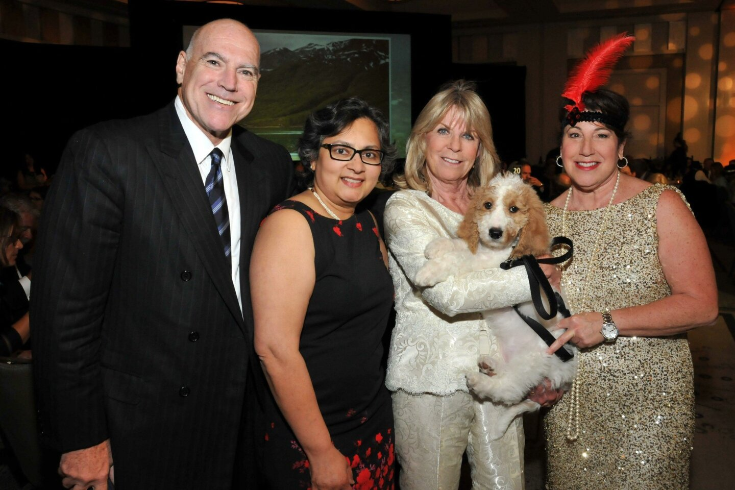 Ralph Whitworth (cancer patient of Dr. Koka), Dr. Anuradha Koka, Lynn Prudhomme (with the auction puppy, which went for $6,500), Amy Weiner