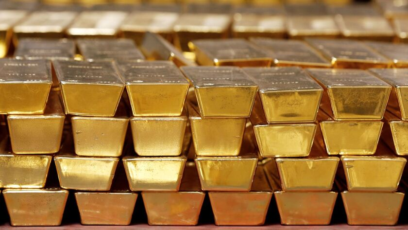 As flights are grounded globally, some large dealers are unsure of whether they'll be able to transport bullion as normal. Above, gold bars in a vault in West Point, N.Y.