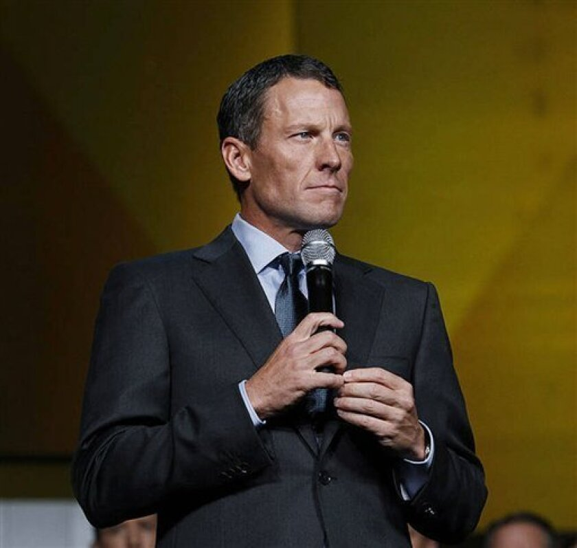 "FILE – In this Oct. 19, 2012, file photo provided by Livestrong, Lance Armstrong speaks in Austin, Texas, at the 15th anniversary celebration of Livestrong. ""The mission is bigger than me. It's bigger than any individual,"" Armstrong told the gathering at the cancer-fighting charity he founded. As a"