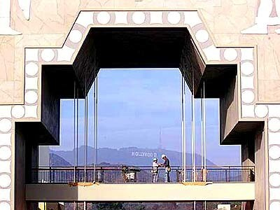 The Hollywood sign can be seen from the main courtyard at the Hollywood & Highland  complex, opening this week and expected to draw both tourists and Southland residents.