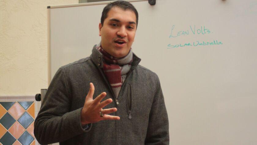 Start-Biz Club presenter Faizan Masood shares his concept of a solar-power collecting umbrella and charging station