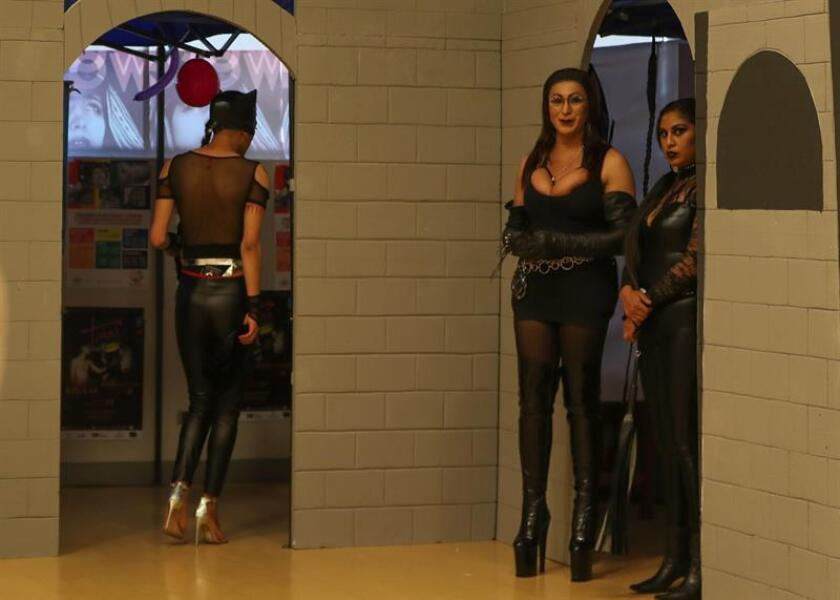 Photo of participants in the exhibition in Bolivia on Nov. 23, 2018, that portrays the taboos related to transsexuality, lesbianism, male and female transvestism, sex in old age and bondage. EFE-EPA/Martin Alipaz