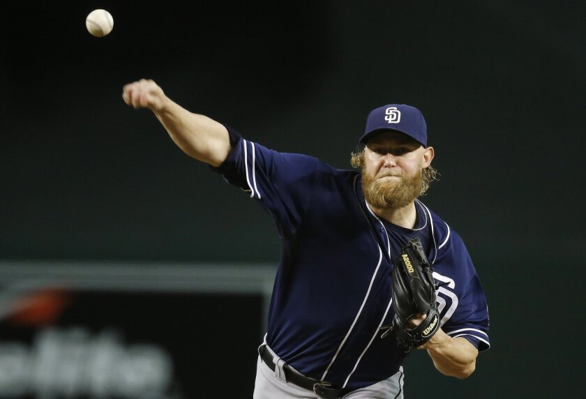 San Diego Padres' Andrew Cashner throws a pitch against the Arizona Diamondbacks during the first inning of a baseball game Wednesday, Sept. 16, 2015, in Phoenix. (AP Photo/Ross D. Franklin)