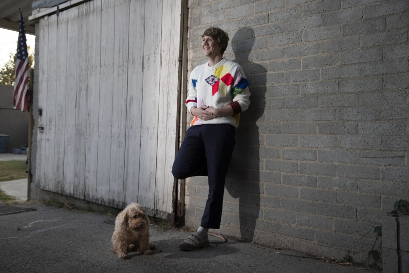 "Josh Thomas with his dog, John, during post-production on ""Everything's Gonna Be Okay"""