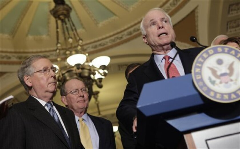 Sen. John McCain, R-Ariz., right, accompanied by Senate Minority leader Mitch McConnell of Ky., left, and Sen. Lamar Alexander, R-Tenn. speak to members of the media on Capitol Hill in Washington, Tuesday,Dec. 1, 2009. (AP Photo/Pablo Martinez Monsivais)