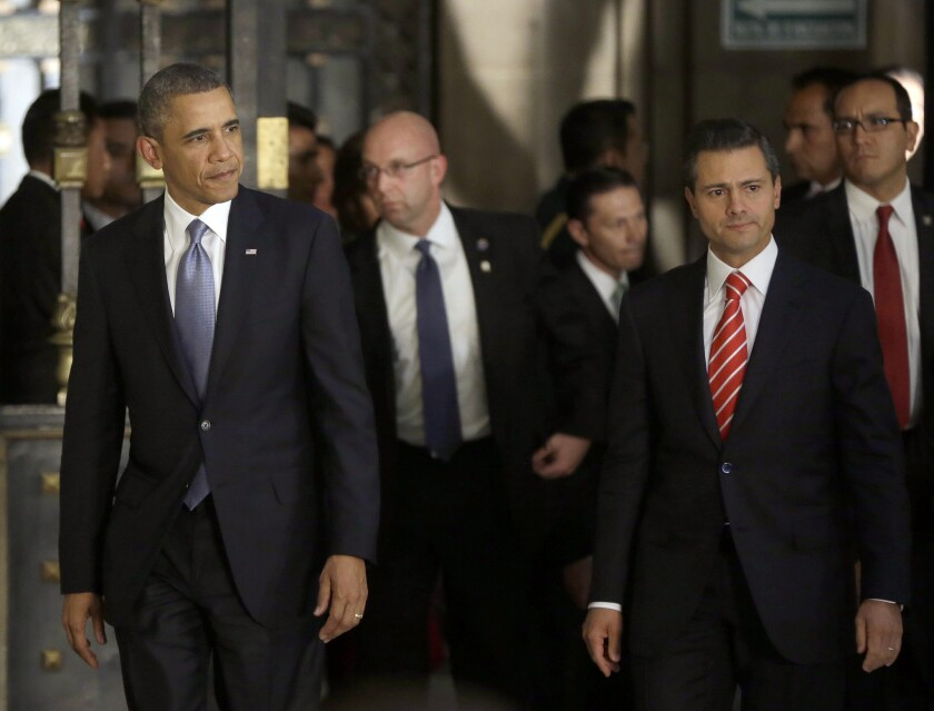 President Obama, left, and Mexican President Enrique Peña Nieto, right, arrive for a news conference at the National Palace in Mexico City.