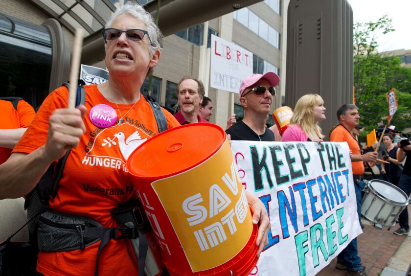 Protesters hold a rally in favor of net neutrality outside the Federal Communications Commission in May.