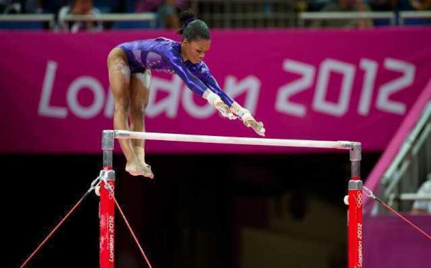 U.S. women's gymnastics team still in first after uneven bars