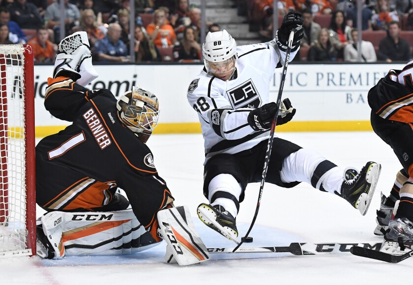 Kings right wing Jarome Iginla trips while trying to get a shot on goal against the Ducks' Jonathan Bernier during the second periodSunday at Honda Center.