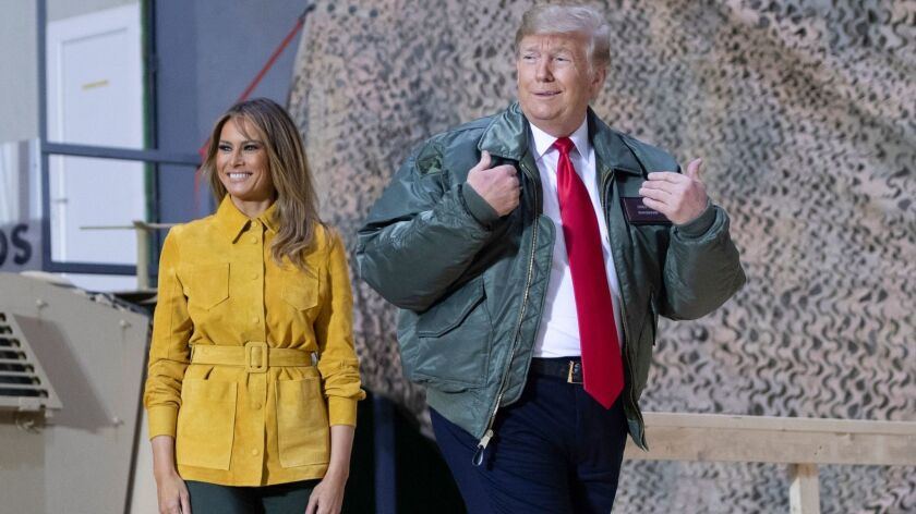 President Trump and First Lady Melania Trump arrive at Asad Air Base in Iraq on Wednesday.