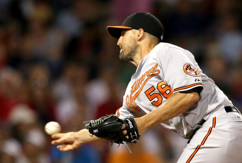 Baltimore Orioles reliever Darren O'Day throws a pitch during the eighth inning of a game against the Boston Red Sox on June 23.