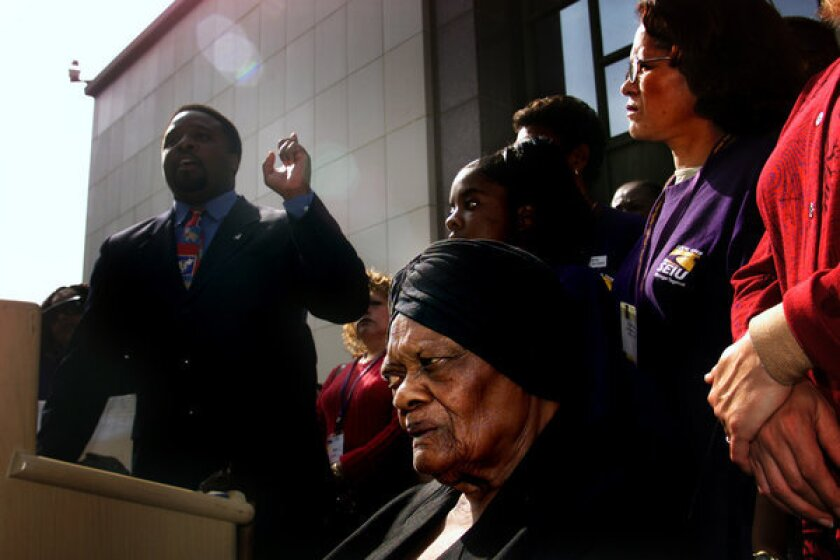 """Until his fall from grace, Tyrone Freeman, shown above left in a 2002 file photo, represented about 190,000 home-care workers in the SEIU chapter and an affiliated local, whose members made as little as $9 an hour. """"May God have mercy on me,"""" said Freeman before he was sentenced. """"I am accountable for these bad decisions."""""""