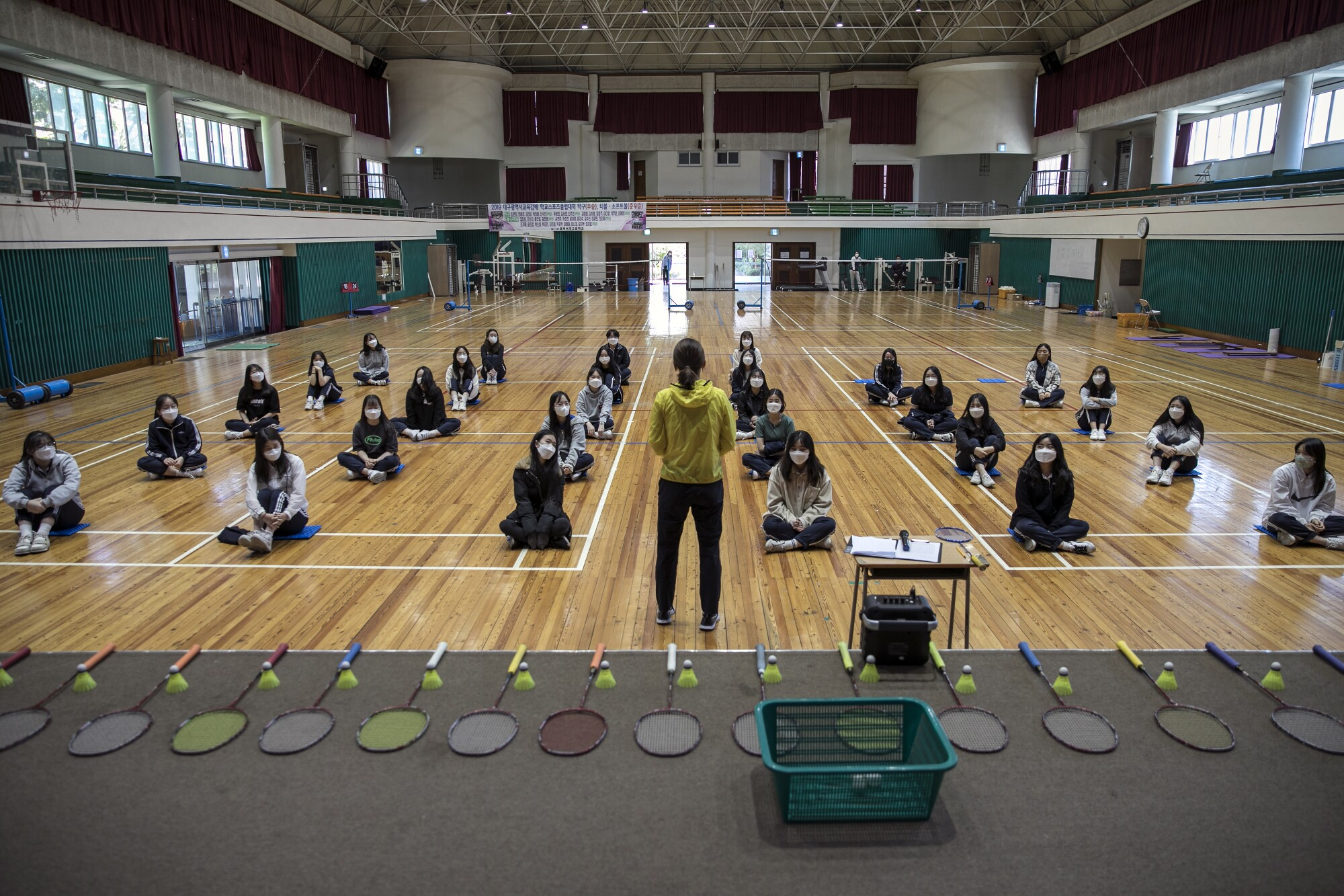 Students gear up for PE on May 20, 2020, their first day back at Gyungbuk Girls' High School in Daegu, South Korea, after a lengthy closure due to the COVID-19 pandemic. Daegu was at the center of South Korea's coronavirus outbreak.