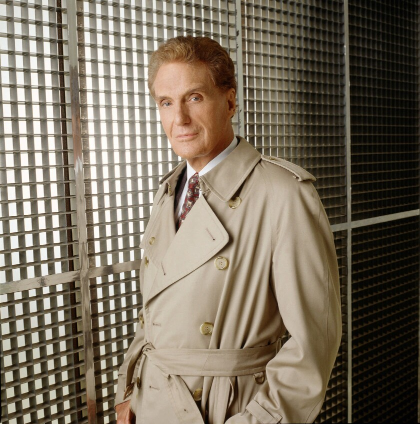 """Actor Robert Stack, who died in 2003, hosted """"Unsolved Mysteries"""" during the show's heyday."""