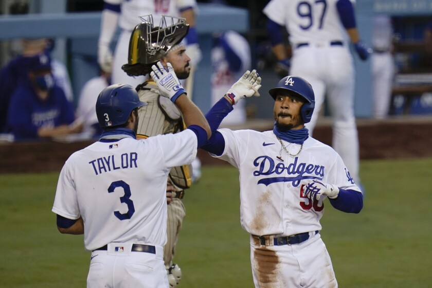 Los Angeles Dodgers' Mookie Betts, right, celebrates his two-run home run with Chris Taylor.