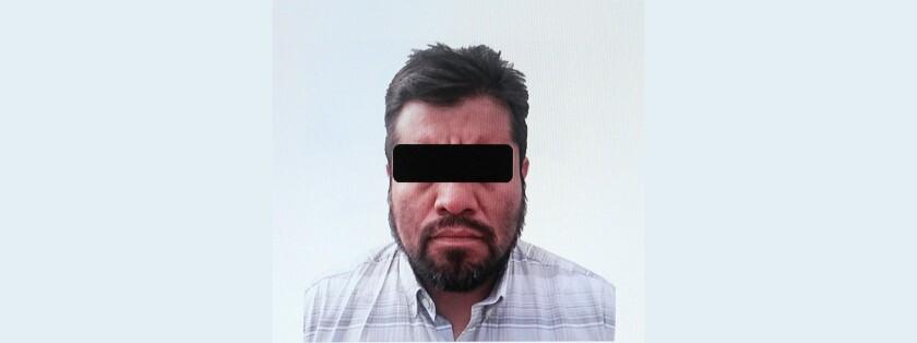 La Policía Federal de México presenta hoy, viernes 12 de agosto de 2016, en Ciudad de México (México), una proyección con la imagen de Luis Reyes Enríquez, presunto fundador y líder del cártel de Los Zetas, detenido tras una operación en el municipio mexicano de San Pedro Garza García, en el norteño estado de Nuevo León (México). EFE/Alex Cruz.