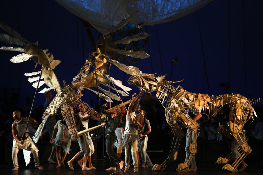 Pole-operated puppets provide the backdrop to Stravinsky.