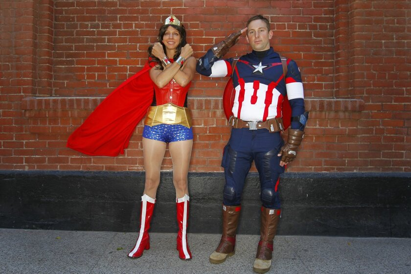 Shelly McCarter and Ennis O'Connor dressed as Wonder Woman and Captain America at Comic-Con.