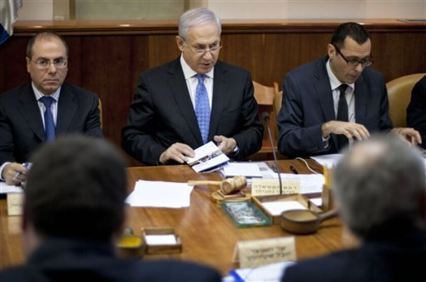 Israeli Prime Minister Benjamin Netanyahu, center, attends the weekly cabinet meeting in his Jerusalem office, Sunday, April 3, 2011. The head of a U.N.-appointed expert panel that investigated the Gaza war between Israel and Hamas with the alleged deliberately targeted civilians in the winter of 2008-2009, Richard Goldstone said in a newspaper article published in the U.S. newspaper Washington Post Friday April 1, 2011, that new accounts by Israel's military indicate that his conclusions should have been different, and Netanyahu has called for the Goldstone Report to be formally nullified. (AP Photo/Sebastian Scheiner, Pool)