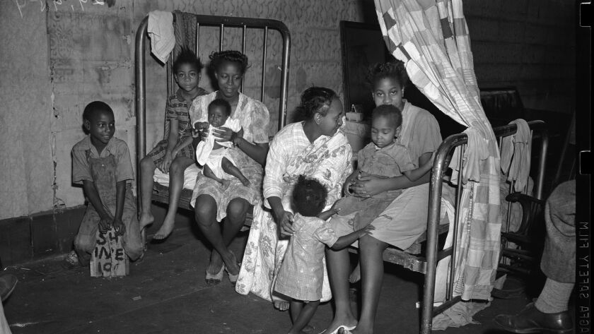 A family of African American war workers in a makeshift bedroom in Little Toyko, Los Angeles. Littl