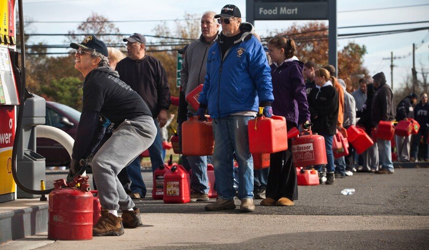 New Jersey residents line up to fill their gas cans at a service station in Hazlet Township after Superstorm Sandy. The Energy Department plans to create a gas reserve in the Northeast to prevent fuel shortages brought by extreme weather.