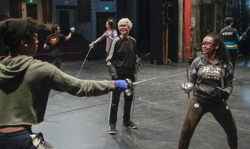 "Randi McKenzie (center) puts students through their paces in the ""Foiling Around"" theatrical swordfighting course at SDSU."
