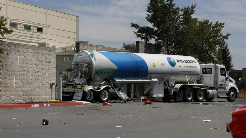Debris is scattered near a tanker truck carrying liquid oxygen at the Kaiser Permanente medical offi