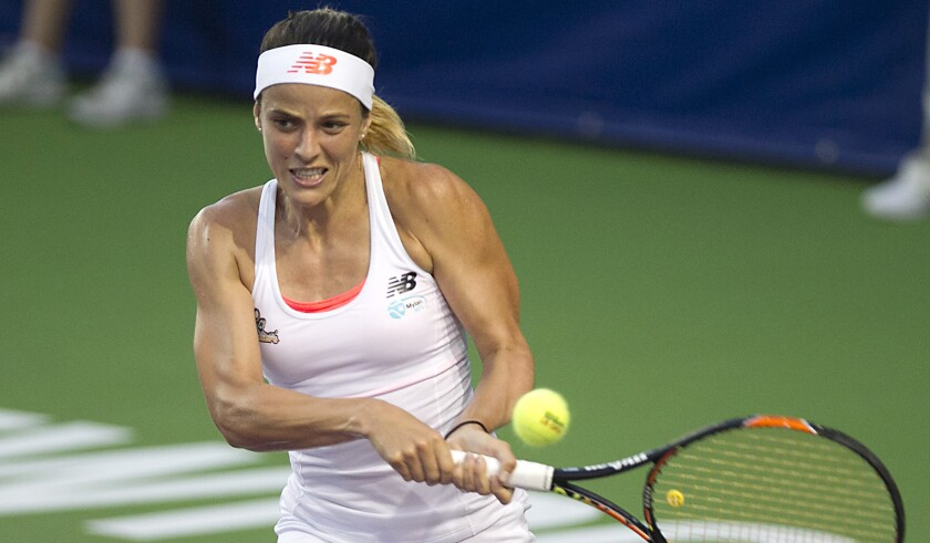 Nicole Gibbs makes a backhand return during a World Team Tennis match for the Orange County Breakers in 2016. Gibbs is making a comeback to the sport after undergoing surgery and treatment to remove a tumor in her mouth.