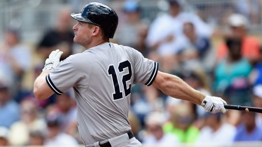 Chase Headley hits a solo home run against the Minnesota Twins during the fifth inning of a game on July 26, 2015, at Target Field in Minneapolis.