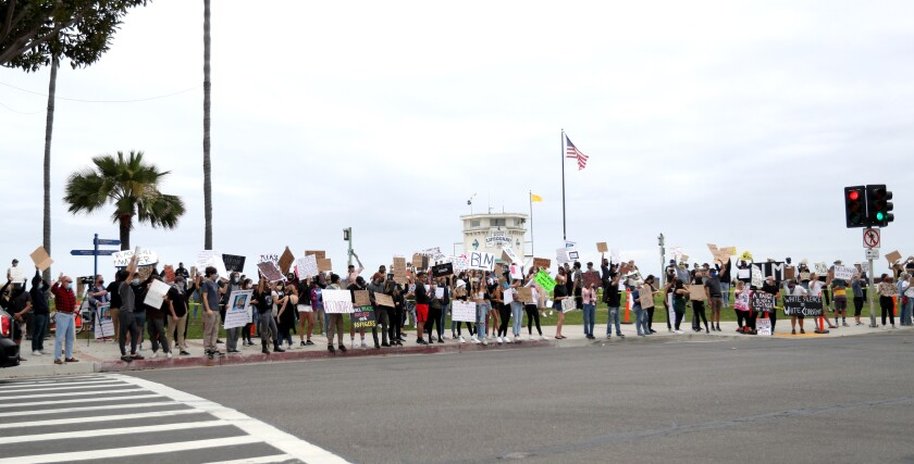Dozens of Black Lives Matter protesters held signs and chanted at Main Beach Park in Laguna Beach on Friday, June 5, 2020.