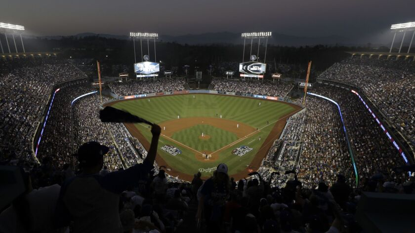 Fans cheer from the top of Dodger Stadium during Game 4 of the World Series between the Boston Red Sox and Dodgers on Oct. 27.