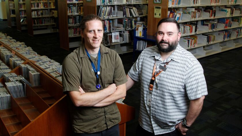 """Kristopher Jorgensen, left, and JP Baker, librarians at the County's library branch in Vista, are starting up North County's first """"Fixit Clinic."""""""