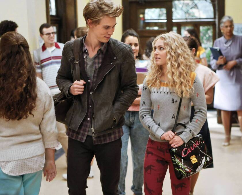 "Austin Butler as Sebastian and AnnaSophia Robb as Carrie in the CW's ""The Carrie Diaries."""