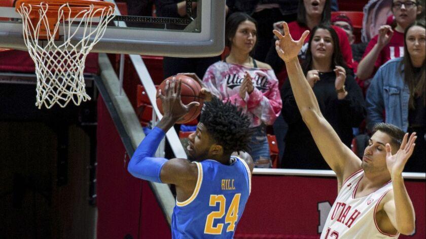 UCLA guard Jalen Hill (24) grabs a rebound against Utah forward Novak Topalovic (13) in the first ha