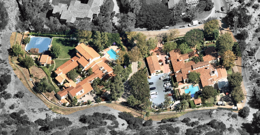 The two-house compound sits behind the gates of Malibu's Serra Retreat community.